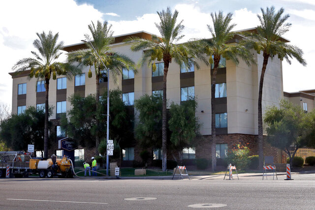 A Hampton Inn is shown Tuesday, July 21, 2020 in Phoenix. The Trump administration is detaining immigrant children as young as 1 in hotels before deporting them to their home countries. Documents obtained by The Associated Press show a private contractor hired by U.S. Immigration and Customs Enforcement is taking children to three Hampton Inns in Arizona and Texas under restrictive border policies implemented during the coronavirus pandemic.  (AP Photo/Matt York)