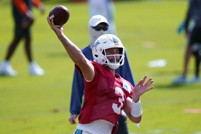 Miami Dolphins quarterback Josh Rosen (3) throws during practice at the NFL football team's training facility, Friday, Aug. 21, 2020, in Davie, Fla. Miami Dolphins quarterback Ryan Fitzpatrick is missing practice for personal reasons. Fitzpatrick's absence left Rosen and top draft pick Tua Tagovailoa to take snaps Friday. (AP Photo/Lynne Sladky)