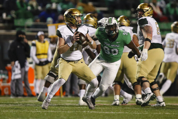UAB quarterback Tyler Johnston (17) looks to make a pass as the Blazers take on Marshall  during an NCAA college football game for the Conference USA Football Championship on Friday, Dec. 18, 2020,  in Huntington, W.Va.  (Sholten Singer/The Herald-Dispatch via AP)