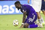 Orlando City's Daryl Dike reacts after narrowly missing a goal during against CF Montreal during an MLS soccer match in Orlando, Fla., Wednesday, Sept. 15, 2021. (Stephen M. Dowell/Orlando Sentinel via AP)