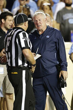 North Carolina head coach Mack Brown, right, argues with an official during the second half of an NCAA college football game against Duke in Chapel Hill, N.C., Saturday, Oct. 26, 2019. (AP Photo/Gerry Broome)