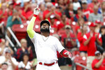 St. Louis Cardinals' Marcell Ozuna celebrates after hitting a triple during the second inning of a baseball game against the Colorado Rockies Sunday, Aug. 25, 2019, in St. Louis. (AP Photo/Jeff Roberson)