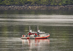 Two U.S. Coast Guard 45-foot response boats drift through George Inlet as part of a search effort on Tuesday, May 14, 2019, near Ketchikan, Alaska, at the site of a collision between two float planes. Dive teams plunged into the icy cold waters of the southeast Alaska inlet Tuesday, searching an area the size of 24 football fields for two cruise ship passengers missing after two sightseeing planes collided. (Dustin Safranek/Ketchikan Daily News via AP)