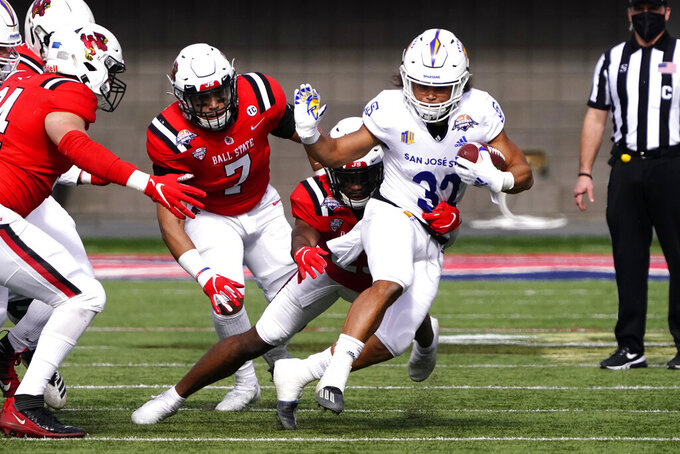 San Jose State running back Kairee Robinson (32) runs for a first down against Ball State in the first half of the Arizona Bowl NCAA college football game, Thursday, Dec. 31, 2020, in Tucson, Ariz. (AP Photo/Rick Scuteri)