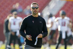 "File-This Oct. 27, 2018, file photo shows Texas Tech head coach Kliff Kingsbury standing on the field before an NCAA college football game against Iowa State, in Ames, Iowa. A win in their regular season finale at Texas last season likely saved Kingsbury's job. It is unclear what impact, if any, the outcome of this game might have on Kingsbury's future. ""Dealt with a lot of that last year, and this year the focus has just been on our team and our program and these seniors, and so that's what my focus is this week is, hey, how can we extend this season for these seniors,"" Kingsbury said.  (AP Photo/Charlie Neibergall, File)"