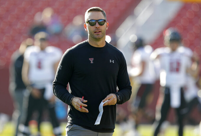 """File-This Oct. 27, 2018, file photo shows Texas Tech head coach Kliff Kingsbury standing on the field before an NCAA college football game against Iowa State, in Ames, Iowa. A win in their regular season finale at Texas last season likely saved Kingsbury's job. It is unclear what impact, if any, the outcome of this game might have on Kingsbury's future. """"Dealt with a lot of that last year, and this year the focus has just been on our team and our program and these seniors, and so that's what my focus is this week is, hey, how can we extend this season for these seniors,"""" Kingsbury said.  (AP Photo/Charlie Neibergall, File)"""