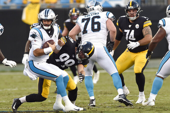 Pittsburgh Steelers linebacker Christian Kuntz (99) moves in to sack Carolina Panthers quarterback Will Grier (3) during the first half of an NFL preseason football game in Charlotte, N.C., Thursday, Aug. 29, 2019. (AP Photo/Mike McCarn)