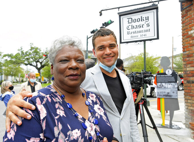 Leona Tate, left, who is known as one of the McDonogh Three who first integrated McDonogh No. 19, stands with artist Ernest M. English who helped design the historical marker unveiled outside of Dooky Chase's Restaurant on Orleans Avenue that honors significant locations in the Civil Rights movement in New Orleans, Monday, May 3, 2021. Dooky Chase's Restaurant was honored because it was a common meeting point for leaders of the Civil Rights movement during the era of segregation. The Louisiana Civil Rights Trail markers project will eventually include 15 locations. (Max Becherer/The Times-Picayune/The New Orleans Advocate via AP)