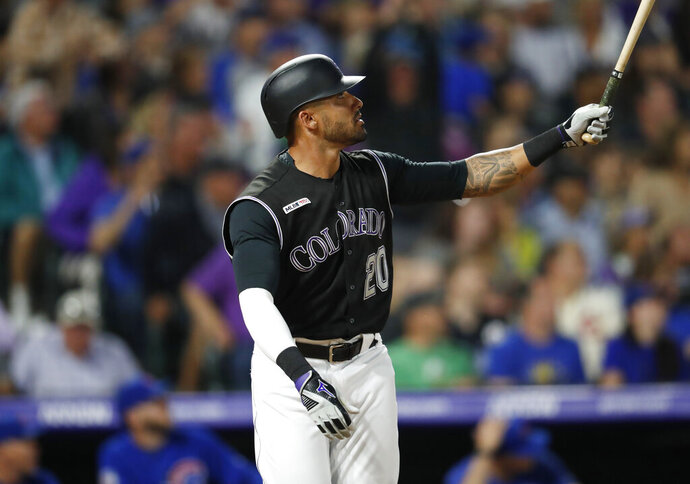 Colorado Rockies pinch-hitter Ian Desmond follows the flight of his solo home run off Chicago Cubs relief pitcher Mike Montgomery in the seventh inning of a baseball game Monday, June 10, 2019, in Denver. (AP Photo/David Zalubowski)