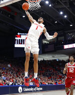 Dayton's Obi Toppin (1) dunks as Massachusetts' Carl Pierre (12) during the first half of an NCAA college basketball game, Saturday, Jan. 11, 2020, in Dayton. (AP Photo/John Minchillo)
