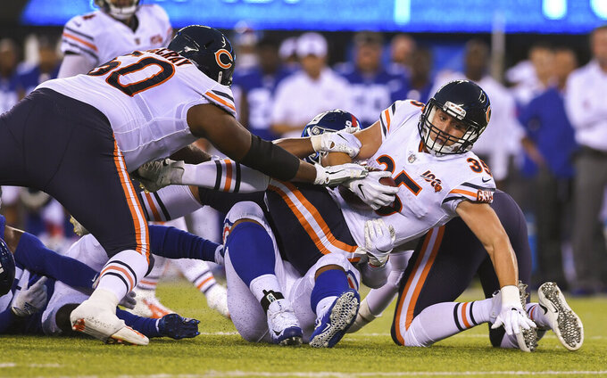 Chicago Bears running back Ryan Nall (35) is tackled by the New York Giants during the second quarter of a preseason NFL football game, Friday, Aug. 16, 2019, in East Rutherford, N.J. (AP Photo/Sarah Stier)
