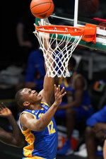 Pittsburgh forward Abdoul Karim Coulibaly dunks the ball during the second half of an NCAA college basketball game against Miami, Wednesday, Dec. 16, 2020, in Coral Gables, Fla. (AP Photo/Wilfredo Lee)