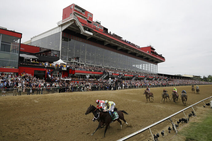 FILE - In this May 20, 2017, file photo, Cloud Computing (2), ridden by Javier Castellano, left, wins 142nd Preakness Stakes horse race at Pimlico race course as Classic Empire (5) with Julien Leparoux aboard takes second, in Baltimore. The future of Pimlico has turned into a tug of war involving city officials, who want it to stay in Baltimore, and the owners of the track, who long to move the second jewel of the Triple Crown to nearby Laurel. (AP Photo/Matt Slocum, File)