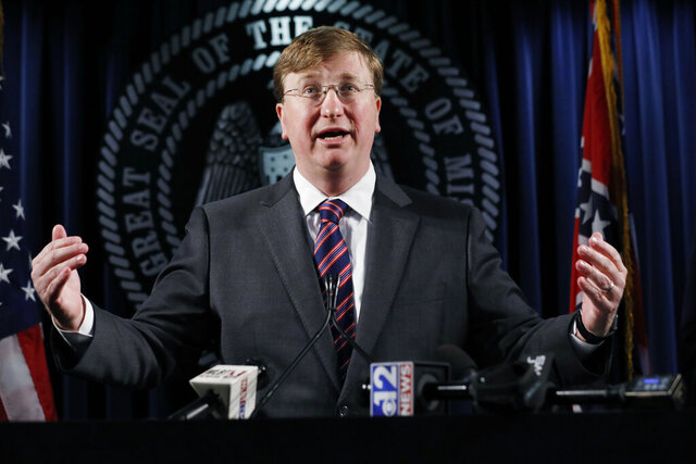 Republican Gov. Tate Reeves reacts to a question during a news conference regarding his establishing a diverse group of experienced Mississippians to help with a nationwide search for a new Mississippi Department of Corrections (MDOC) commissioner, Thursday, Jan. 16, 2020. (AP Photo/Rogelio V. Solis)