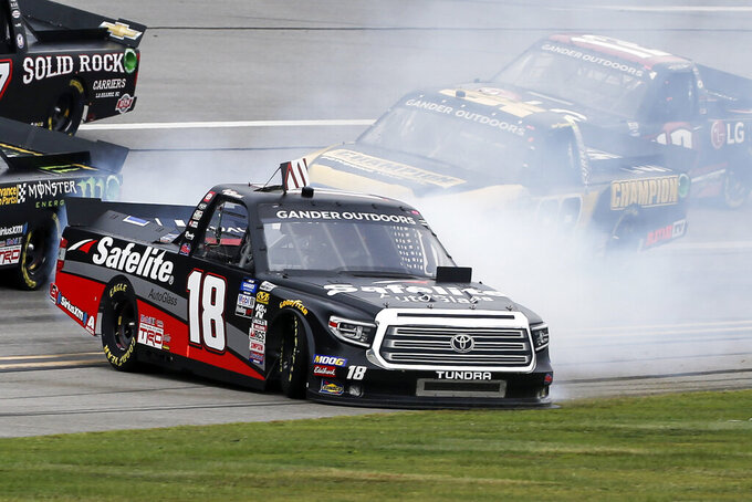 Camping World Truck Series driver Harrison Burton (18) spins out in the tai-oval during the Sugarlands Shine 250 at Talladega Superspeedway, Saturday, Oct 12, 2019, in Talladega, Ala. (AP Photo/Butch Dill)