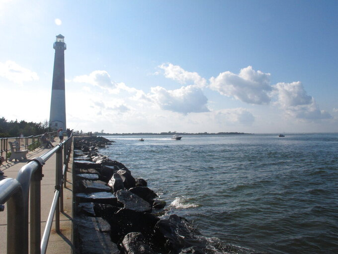 This Sept. 18, 2021 photo shows the Barnegat Inlet in Barnegat Light N.J. where a storm gate would be constructed across the inlet as part of a $16 billion storm control project being proposed by the U.S. Army Corps of Engineers. A public hearing on the proposal was to be held on Tuesday, Sept. 21.  (AP Photo/Wayne Parry)