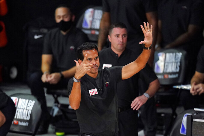 Miami Heat head coach Erik Spoelstradirects his team during the first half in Game 6 of basketball's NBA Finals against the Los Angeles Lakers Sunday, Oct. 11, 2020, in Lake Buena Vista, Fla. (AP Photo/Mark J. Terrill)