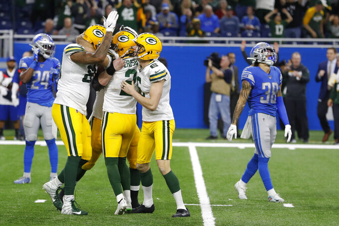 Green Bay Packers surround kicker Mason Crosby (2) after his winning field goal during the second half of an NFL football game against the Detroit Lions, Sunday, Dec. 29, 2019, in Detroit. (AP Photo/Carlos Osorio)