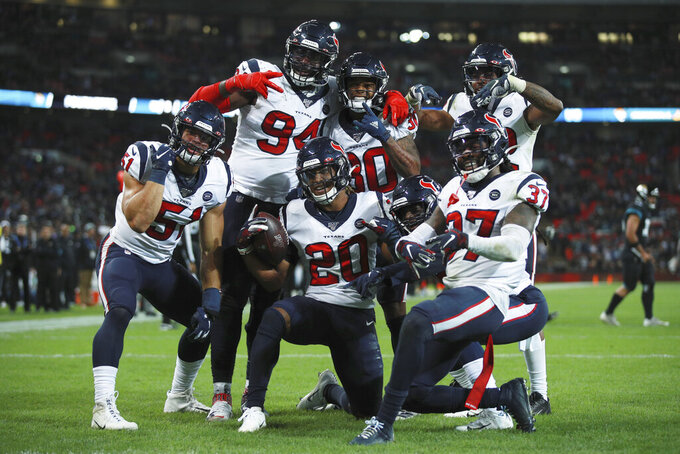 Houston Texans strong safety Justin Reid (20) celebrates his touchdown with teammates during the second half of an NFL football game against the Jacksonville Jaguars at Wembley Stadium, Sunday, Nov. 3, 2019, in London. The Houston Texans won 26-3. (AP Photo/Ian Walton)