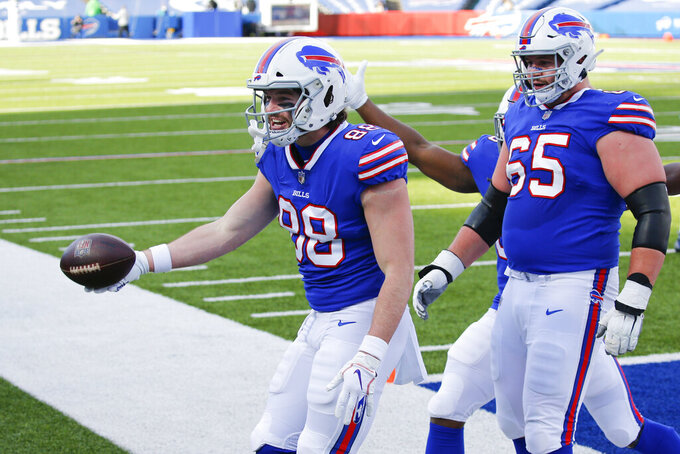 Buffalo Bills tight end Dawson Knox (88) celebrates with teammates after scoring a touchdown during the first half of an NFL wild-card playoff football game against the Indianapolis Colts, Saturday, Jan. 9, 2021, in Orchard Park, N.Y. (AP Photo/Jeffrey T. Barnes)