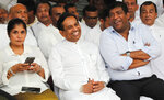 In this Monday, Dec. 23, 2019, photo, former Cabinet minister Rajitha Senaratne, center, sits with colleague Ravi Karunanayake during a protest in Colombo, Sri Lanka. Sri Lankan police arrested the hospitalized former Cabinet minister on Friday, Dec. 27, for alleged involvement in organizing a news conference about abductions under the government of the current president's brother. Lawyer Gunaratna Wanninayake said Senarathna, now an opposition lawmaker, was arrested at a private hospital where he was admitted on Thursday. (AP Photo/Eranga Jayawardena)