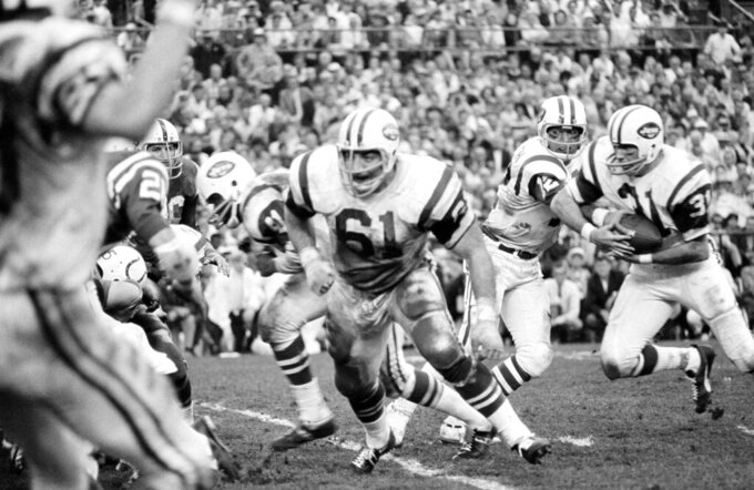 FILE - In this Jan. 13, 1969, file photo, New York Jets' Bill Mathis, far right, takes a handoff from quarterback Joe Namath during Super Bowl III in Miami. Bill Mathis, a versatile running back and an original member of the New York Jets franchise, has died. He was 81. The team announced Mathis' death Tuesday on Wednesday night, Oct. 21, 2020. (AP Photo/Harold Valentine, File)