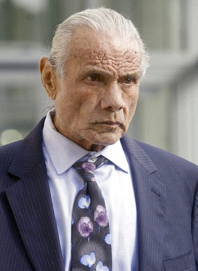 "FILE - In this Nov. 2, 2015, file photo, former professional wrestler Jimmy ""Superfly"" Snuka leaves Lehigh County Courthouse in Allentown, Pa. A federal appeals court on Wednesday, Sept. 9, 2020, dismissed a lawsuit filed by 50 former professional wrestlers, including Snuka, who claimed World Wrestling Entertainment failed to protect them from repeated head trauma including concussions that led to long-term brain damage.   (Michael Kubel/The Morning Call via AP, File)"