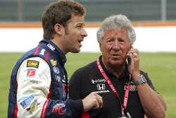 FILE - Marco Andretti, left, talks with Mario Andretti before IndyCar practice laps in Detroit, in this Friday, June 1, 2012, file photo. Marco Andretti made the decision at the start of this year to step away from full-time racing and essentially end three generations of the most famous family in motorsports competing at the highest level. (AP Photo/Dave Frechette, File)