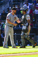 San Francisco Giants pitcher Will Smith, left, and catcher Aramis Garcia congratulate each other after a baseball game against the Atlanta Braves, Sunday, Sept. 22, 2019, in Atlanta. The Giants won 4-1. (AP Photo/John Amis)