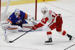 New York Islanders goaltender Thomas Greiss (1) poke checks Detroit Red Wings' Robby Fabbri (14) during the third period of an NHL hockey game Tuesday, Jan. 14, 2020, in Uniondale, N.Y. The Islanders won 8-2. (AP Photo/Frank Franklin II)