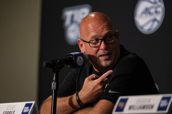 Wake Forest head coach Steve Forbes points while answering a question about guard Daivien Williamson during NCAA college basketball Atlantic Coast Conference media day, Tuesday, Oct. 12, 2021, in Charlotte, N.C. (AP Photo/Matt Kelley)