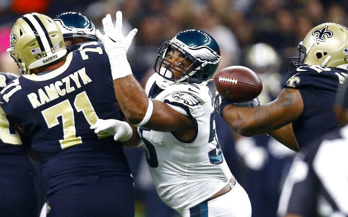 Philadelphia Eagles defensive end Brandon Graham (55) chases the ball after New Orleans Saints quarterback Drew Brees (9) was stripped in the first half of an NFL divisional playoff football game in New Orleans, Sunday, Jan. 13, 2019. (AP Photo/Butch Dill)