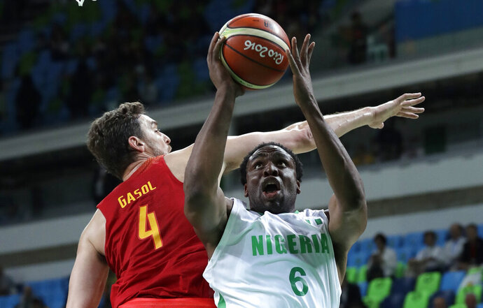 FILE - In this Thursday, Aug. 11, 2016 file photo, Nigeria's Ike Diogu, right, drives to the basket ahead of Spain's Pau Gasol during a basketball game at the 2016 Summer Olympics in Rio de Janeiro, Brazil.  In the 2005 NBA Draft Ike Diogu was the only Nigerian-American, but now fifteen years later, Nigerians are setting records in last week's Draft with two players from Nigeria as first-rounders, and another six who have at least one Nigerian parent were also picked. (AP Photo/Charlie Neibergall, File)