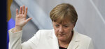German Chancellor Angela Merkel takes the oath of office after she was elected for a fourth term as chancellor in the German parliament Bundestag in Berlin, Germany, Wednesday, March 14, 2018. (AP Photo/Markus Schreiber)