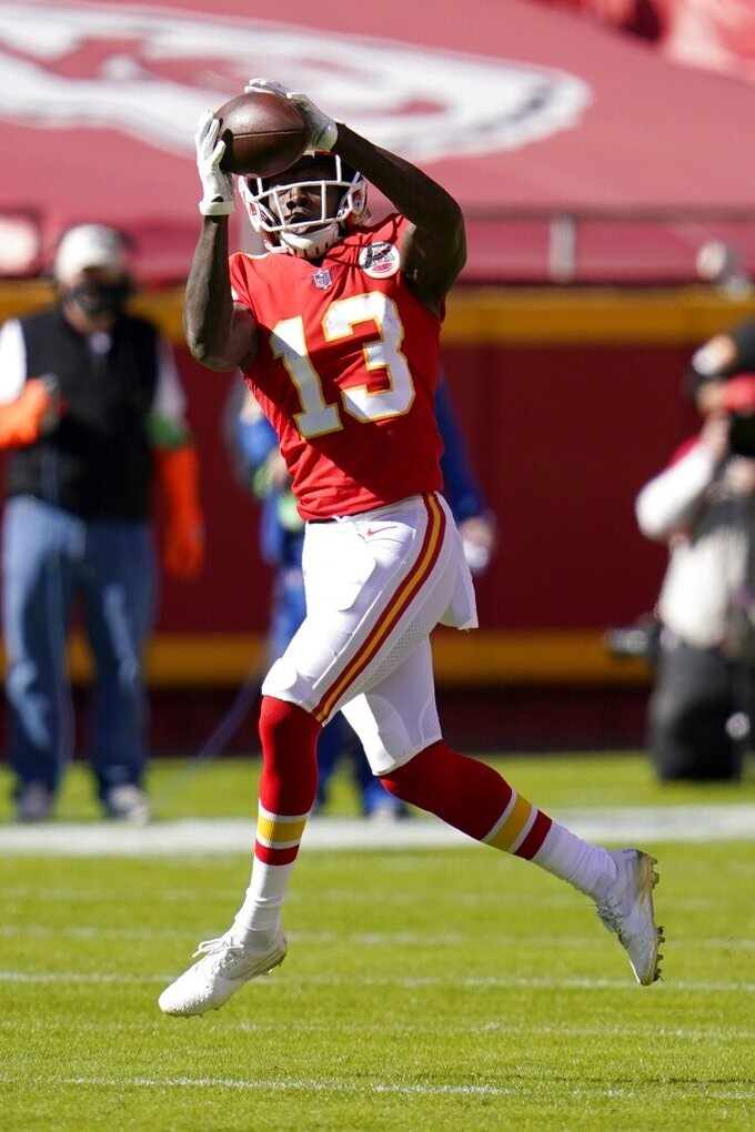 Kansas City Chiefs wide receiver Byron Pringle (13) catches a pass in the first half of an NFL football game against the New York Jets on Sunday, Nov. 1, 2020, in Kansas City, Mo. (AP Photo/Jeff Roberson)