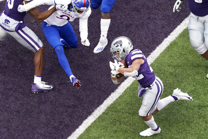Kansas State running back Deuce Vaughn (22) runs into the end zone to score a touchdown during the second half of an NCAA college football game against Kansas, Saturday, Oct. 24, 2020, in Manhattan, Kan. (AP Photo/Charlie Riedel)