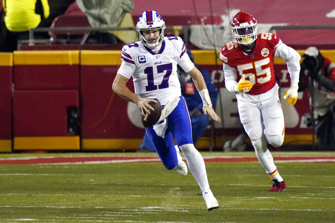 Buffalo Bills quarterback Josh Allen (17) runs from Kansas City Chiefs defensive end Frank Clark (55) during the first half of the AFC championship NFL football game, Sunday, Jan. 24, 2021, in Kansas City, Mo. (AP Photo/Jeff Roberson)