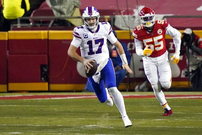 Buffalo Bills quarterback Josh Allen (17) runs from Kansas City Chiefs defensive end Frank Clark (55) during the first half of the AFC championship NFL football game, Sunday, Jan. 24, 2021, in Kansas City, Mo. (AP Photo/Jeff Roberson)