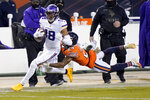 Minnesota Vikings wide receiver Justin Jefferson (18) runs with the ball as Chicago Bears cornerback Buster Skrine (24) defends during the first half of an NFL football game Monday, Nov. 16, 2020, in Chicago. (AP Photo/Nam Y. Huh)