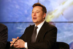 FILE - In this Jan. 19, 2020, file photo Elon Musk, Tesla CEO, speaks during a news conference at the Kennedy Space Center in Cape Canaveral, Fla. Tesla is now worth more than General Motors, Ford and Fiat Chrysler combined, even though the Big Three together sell more cars and trucks in two weeks than Tesla does in a whole year. It is now worth five times what it was in June, when there were whispers of bankruptcy surrounding the company founded by the erratic visionary Musk. (AP Photo/John Raoux, File)