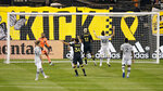 Columbus Crew forward Gyasi Zardes (11) scores a goal against the Montreal Impact during the first half of an MLS soccer match in Columbus, Ohio, Wednesday, Oct. 7, 2020. (Kyle Robertson/The Columbus Dispatch via AP)