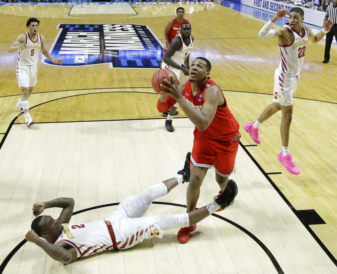 Ohio State's Kaleb Wesson (34) gets pasty Cameron Lard (2) to put up a shot during the second half of a first round men's college basketball game in the NCAA Tournament Friday, March 22, 2019, in Tulsa, Okla. Ohio State won 62-59. (AP Photo/Charlie Riedel)