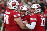 Wisconsin's Jonathan Taylor celebrates his touchdown run with Jason Erdmann (78) and Jack Coan (17) during the first half of an NCAA college football game against PurdueSaturday, Nov. 23, 2019, in Madison, Wis. (AP Photo/Morry Gash)