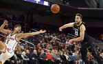 Southern California guard Derryck Thornton, left, and Colorado forward Lucas Siewert reach for a loose ball during the first half of an NCAA college basketball game Saturday, Feb. 9, 2019, in Los Angeles. (AP Photo/Mark J. Terrill)