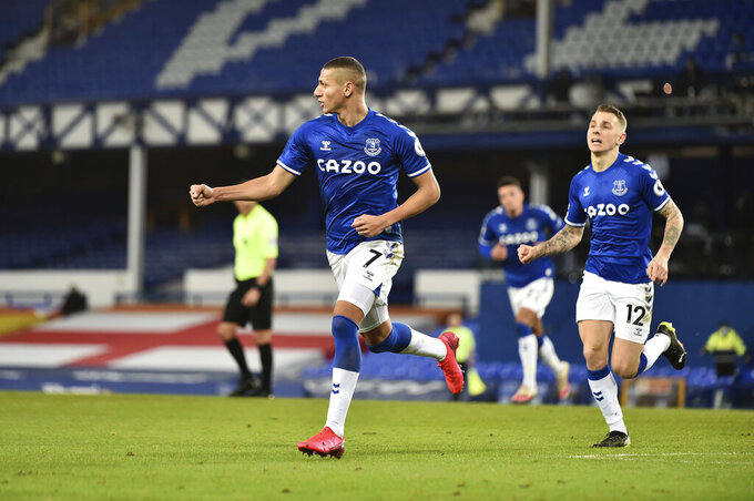 Everton's Richarlison, 7, celebrates scoring his side's first goal during the English Premier League soccer match between Everton and Manchester City at Goodison Park stadium, in Liverpool, England, Wednesday, Feb. 17, 2021. (Peter Powell/Pool via AP)