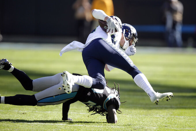 Carolina Panthers cornerback Donte Jackson hits Seattle Seahawks tight end Jacob Hollister, top, during the first half of an NFL football game in Charlotte, N.C., Sunday, Dec. 15, 2019. (AP Photo/Gerry Broome)