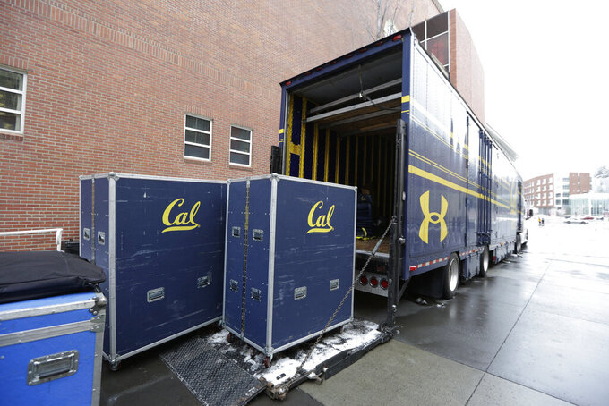 California team equipment sits before loaded into a trailer at Martin Stadium after the NCAA college football game between Washington State and California was canceled because of a case of COVID-19 on the Cal team, Saturday, Dec. 12, 2020, in Pullman, Wash. (AP Photo/Young Kwak)