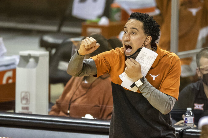 Texas head coach Shaka Smart call out plays to his team against Sam Houston State during the first half of an NCAA college basketball game, Wednesday, Dec. 16, 2020 in Austin, Texas. (Ricardo B. Brazziell/Austin American-Statesman via AP)