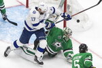 Dallas Stars goaltender Anton Khudobin (35) makes a save on Tampa Bay Lightning center Alex Killorn (17) during overtime of Game 4 of the NHL hockey Stanley Cup Final, Friday, Sept. 25, 2020, in Edmonton, Alberta. (Jason Franson/The Canadian Press via AP)