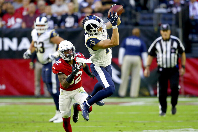 Los Angeles Rams wide receiver Cooper Kupp pulls in a catch as Arizona Cardinals strong safety Budda Baker (32) defends during the first half of an NFL football game, Sunday, Dec. 1, 2019, in Glendale, Ariz. (AP Photo/Ross D. Franklin)